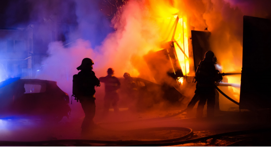 Firefighters fighting fire at night