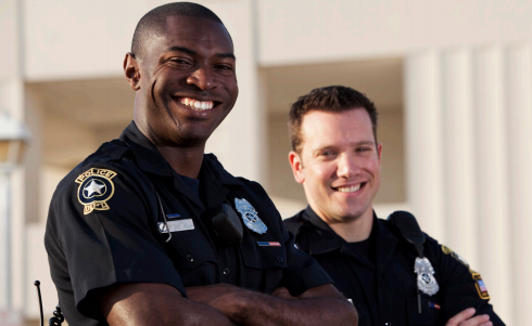 Two police officers smiling.